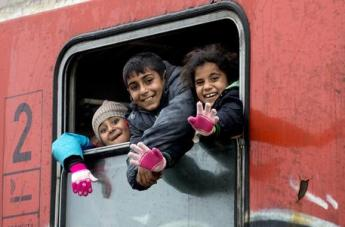 epa05089877 Refugee children wave from the window of the train heading for the Serbian border, near the city of Gevgelija, the Former Yugoslav Republic of Macedonia, 06 January 2016. Serbia, Croatia and Hungary sent groups of police officers to help the Macedonian police in handling of the migrant crisis on the Greek-Macedonian border. Thousands of migrants continue to cross the border and pass through Macedonia on their way to the European Union countries.  EPA/GEORGI LICOVSKI